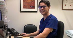 Dr Martin Huynh sitting at desk